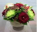 Red Roses with Hypericum in a Grey Ceramic