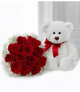 Κόκκινα τριαντάφυλλα με αρκουδάκι
