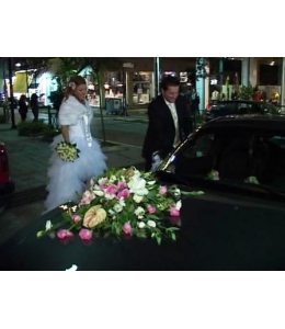 Decoration of the Wedding Car in White and Fuchsia Color
