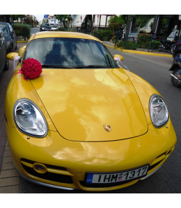 Car Decoration with a bouquet of simple red roses