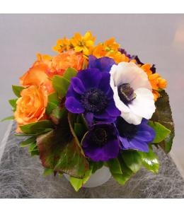 Arrangement of orange roses in pot