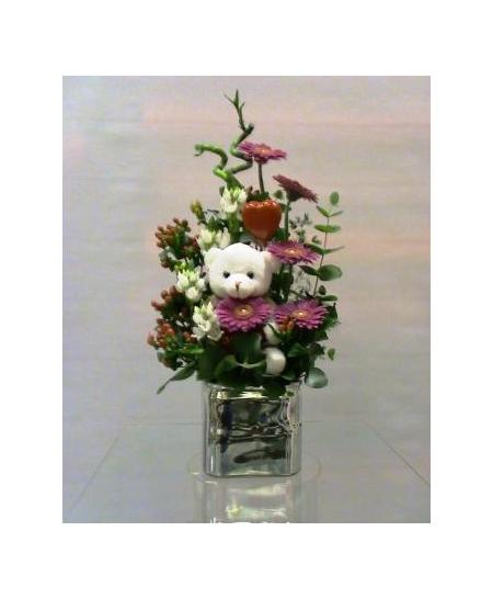 Flower arrangement in glass cube